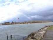Rainbow over Saint-Blaise and the lake
