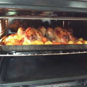 Two chickens snug in the oven