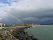 Rainbow over Saint-Blaise and the lake